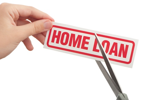 Cutting home loan on white background